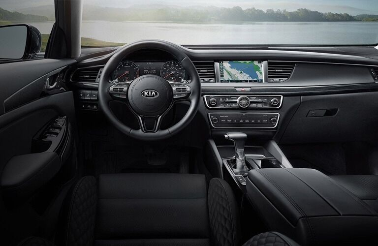 Interior view of the steering wheel and touchscreen inside a 2019 Kia Cadenza