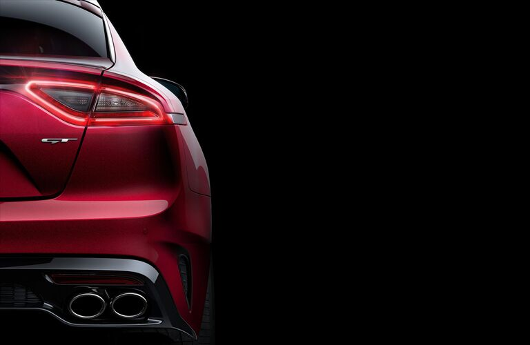 right taillight and exhaust pipes of red kia stinger