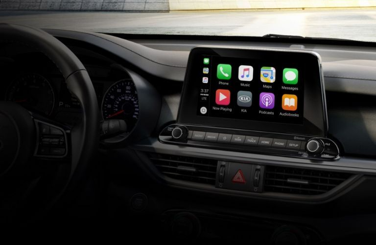 Interior view of Apple CarPlay on the touchscreen display inside a 2020 Kia Forte