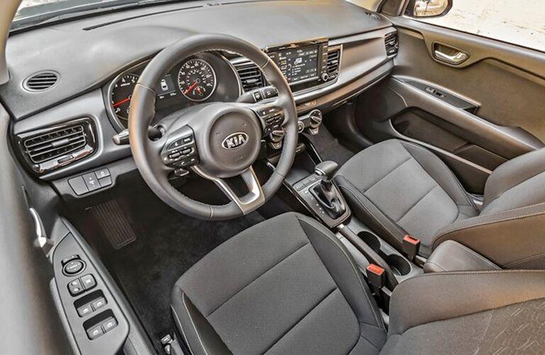 Grey dashboard and front seats in 2020 Kia Rio