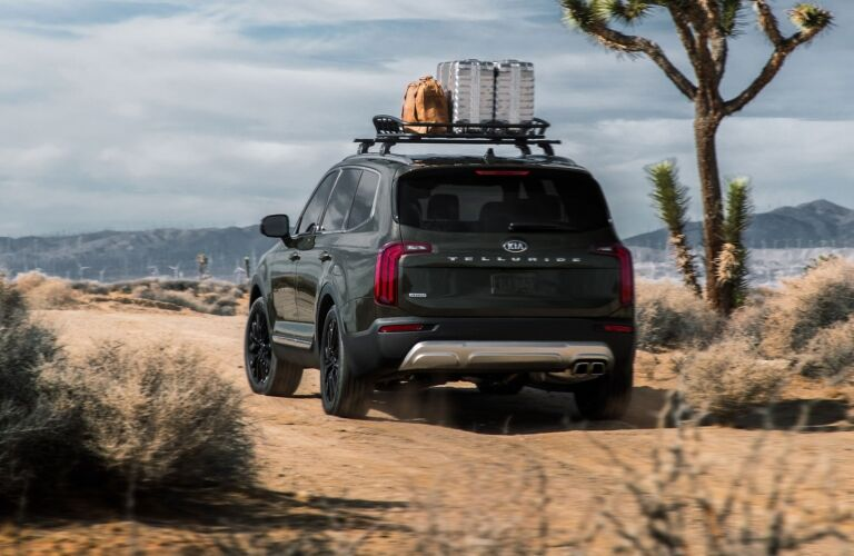 Exterior view of the rear of a green 2020 Kia Telluride parked on a desert path
