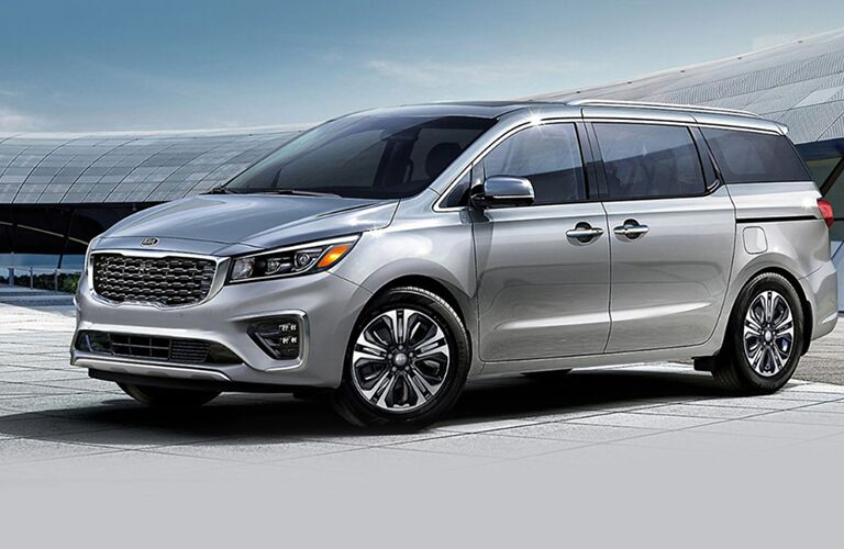 Silver 2021 Kia Sedona Front Exterior in a Parking Lot