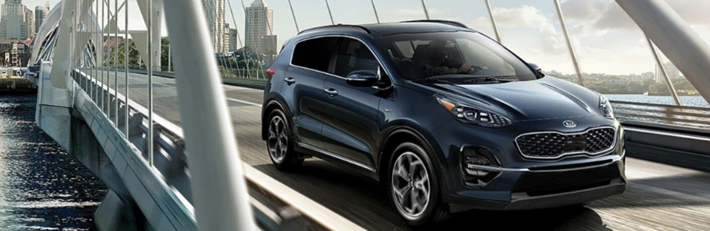 Blue 2021 Kia Sportage on a Bridge