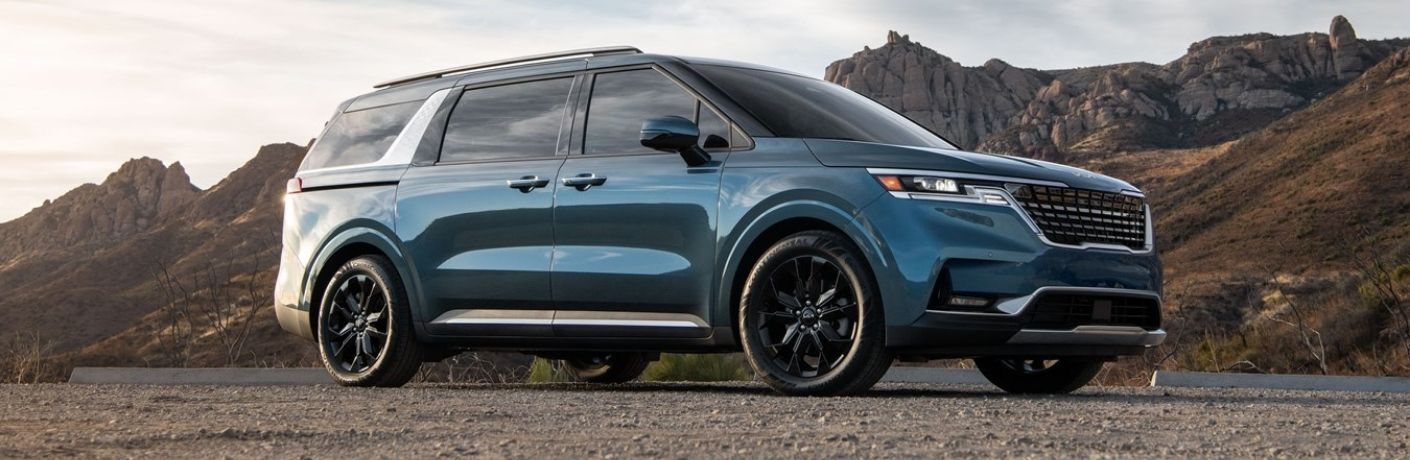 Blue 2022 Kia Carnival Front Exterior in a Desert