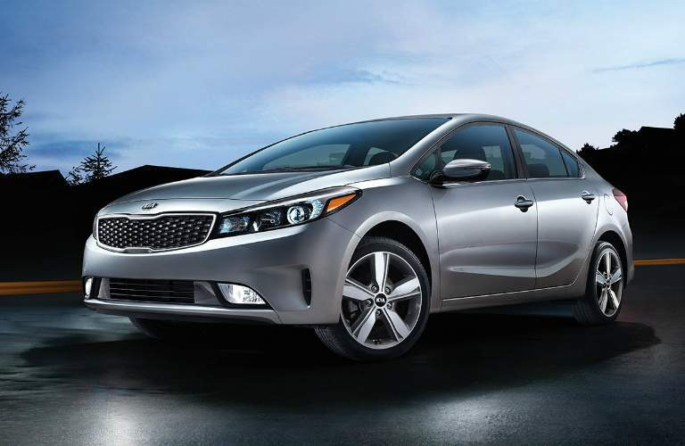 silver 2018 Kia Forte parked outside at night