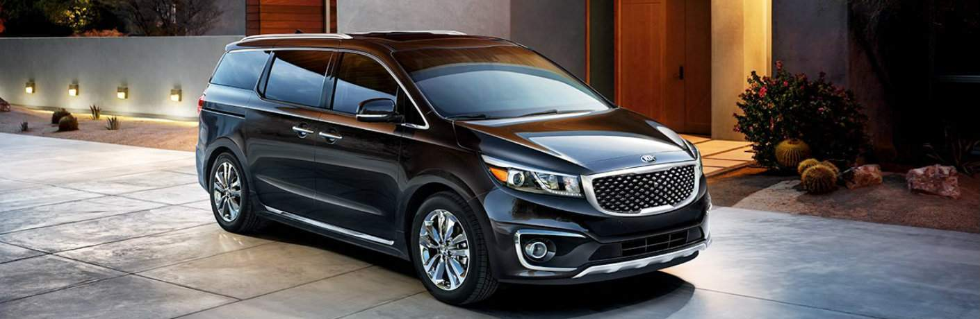 2018 Kia Sedona parked outside home at night