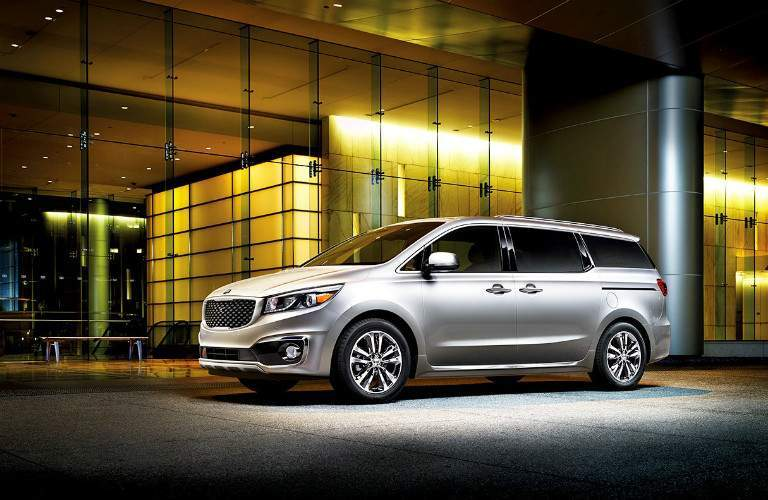 white 2018 Kia Sedona parked outside at night