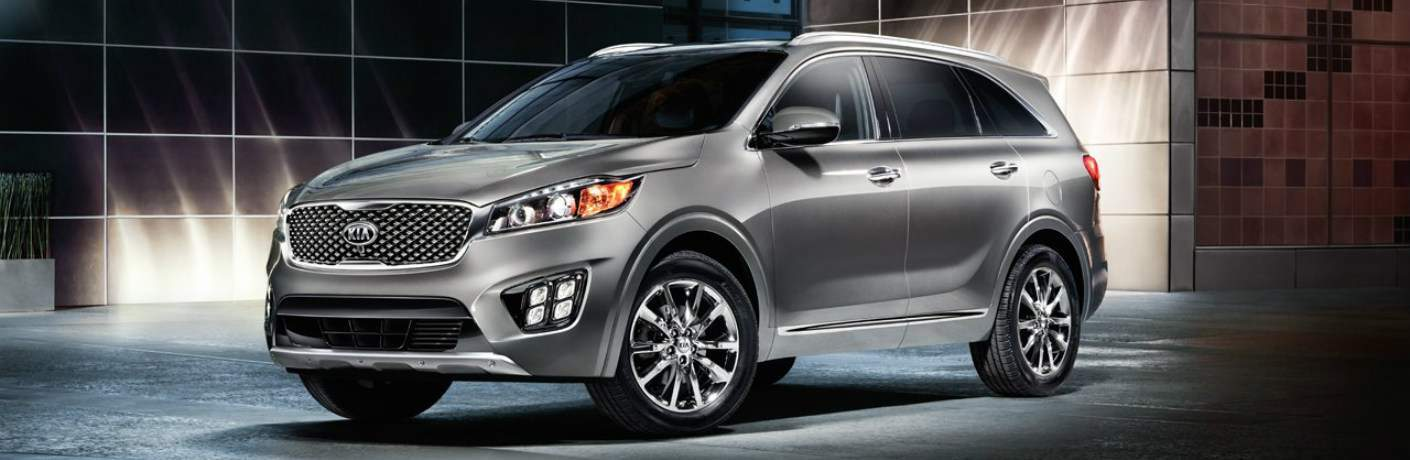 silver 2018 Kia Sorento parked outside house at night