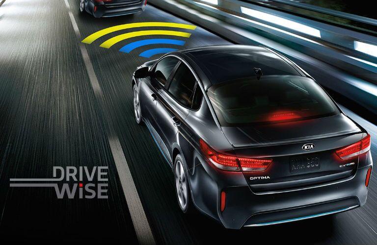 2019 Kia Optima Plug-In Hybrid driving on a road