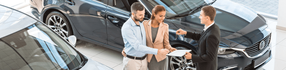 Salesman Assisting Customers at Dealership