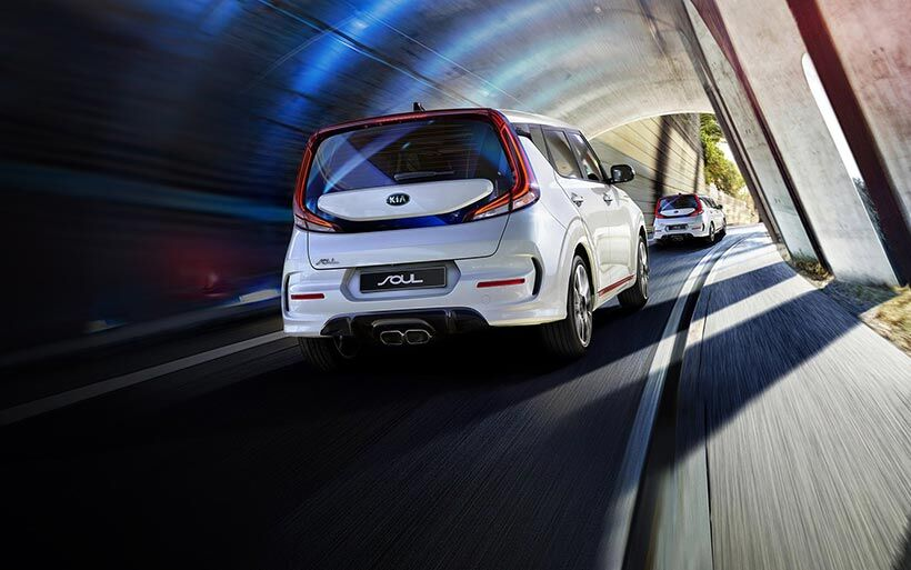 Two 2020 Kia Soul driving down a highway with illustrated distance detection