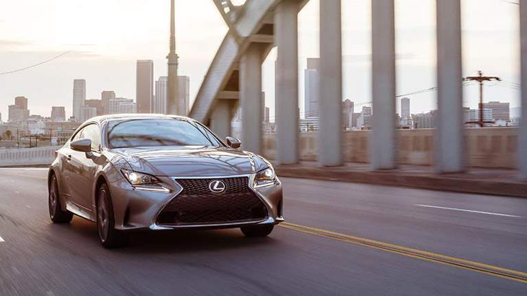 2015 Lexus RC driving on a bridge