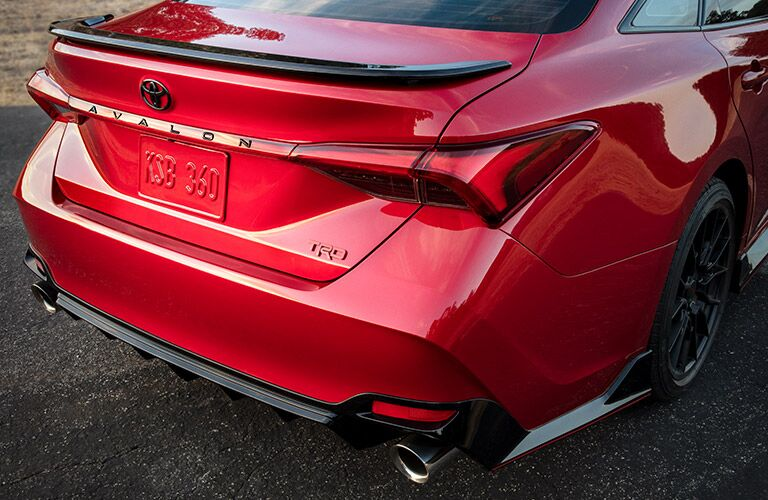 Passenger's side rear angle view of red 2020 Toyota Avalon