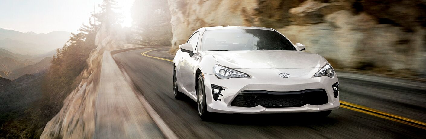 White 2019 Toyota 86 driving on a mountainous road
