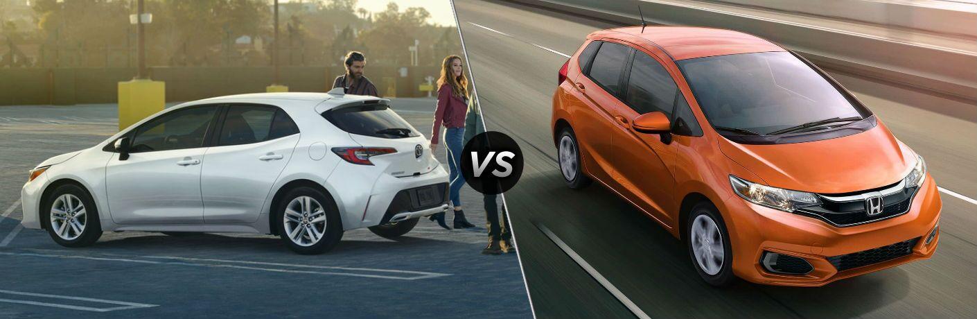 white 2019 Toyota Corolla Hatchback set against orange 2019 Honda Fit