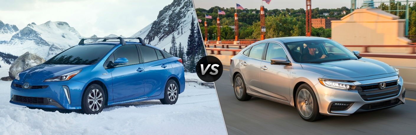blue 2019 Toyota Prius in snow set against silver 2019 Honda Insight