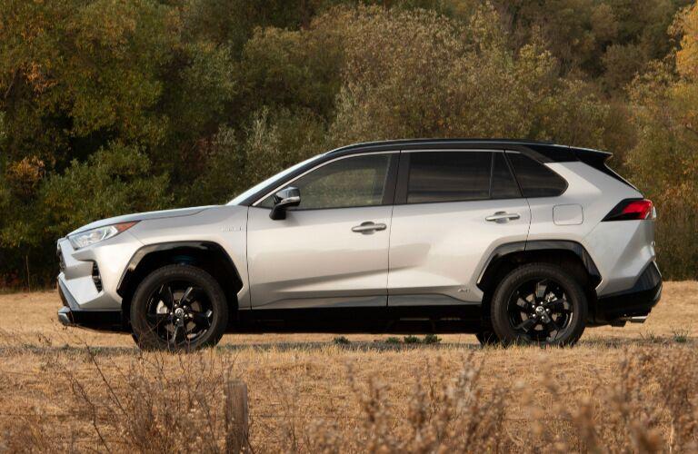 Side view of silver 2019 Toyota RAV4 Hybrid