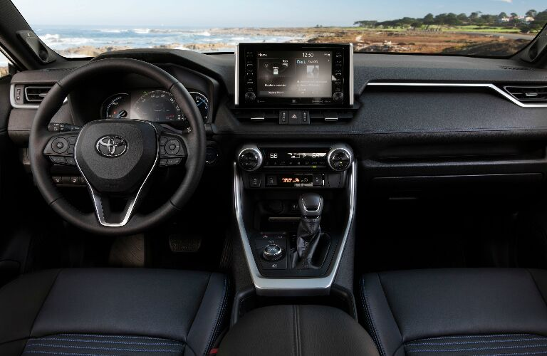 Dashboard and black front seats in 2019 Toyota RAV4 Hybrid