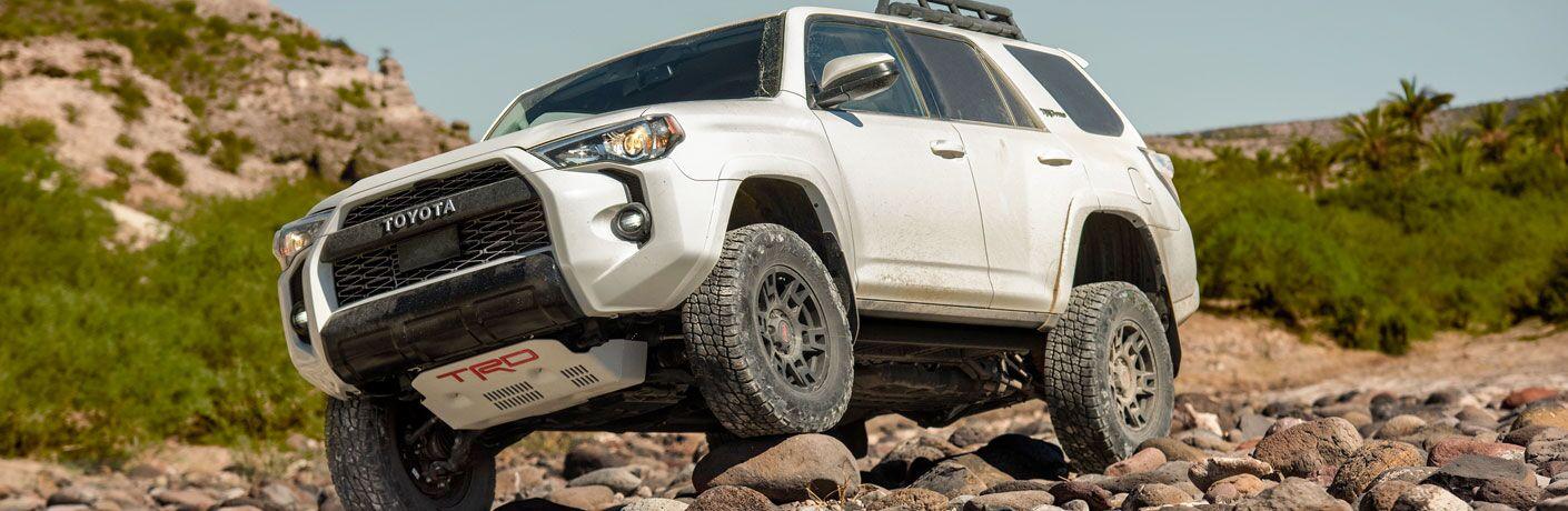White 2020 Toyota 4Runner driving over rocks