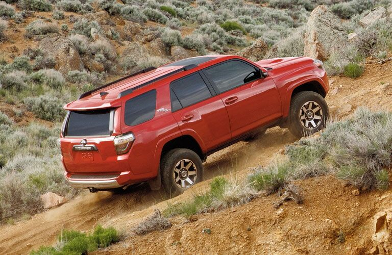 Red 2020 Toyota 4Runner driving up a hill