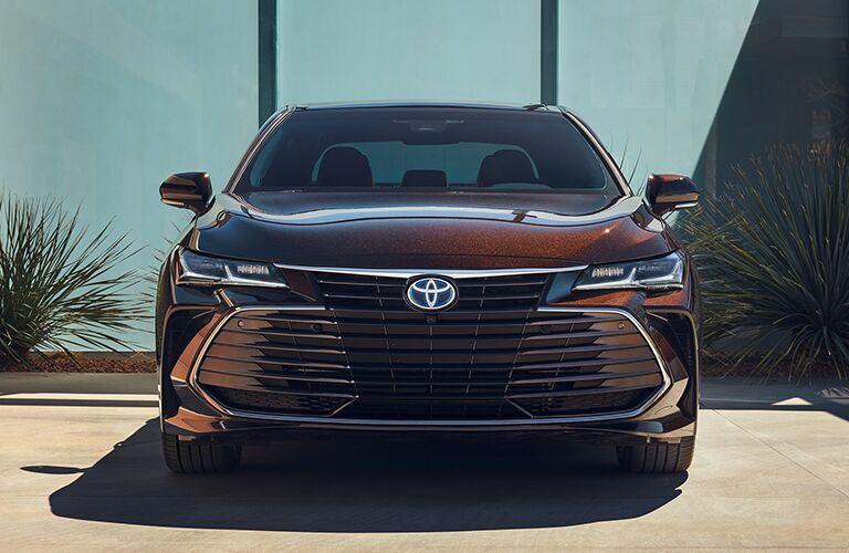 Front view of a reddish-brown 2020 Toyota Avalon Hybrid