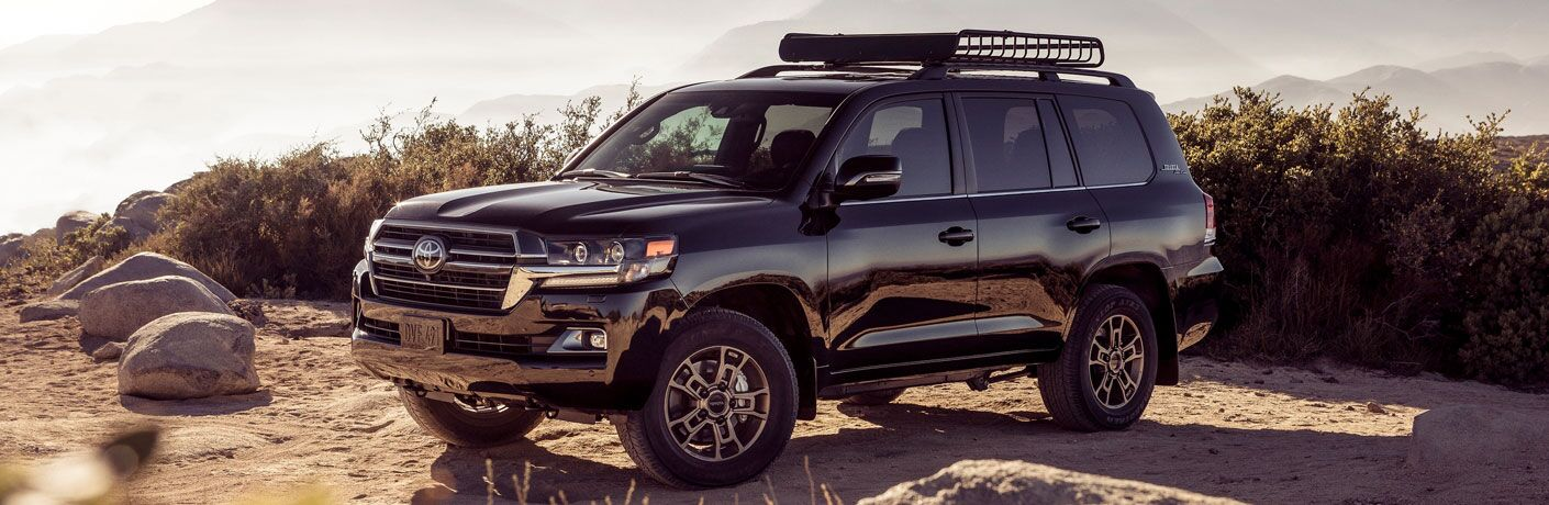 Black 2020 Toyota Land Cruiser parked on top of a rocky hill