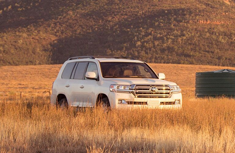 White 2020 Toyota Land Cruiser parked in a meadow