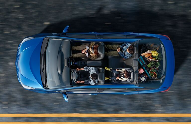 Overhead view of four people inside a 2020 Toyota Prius