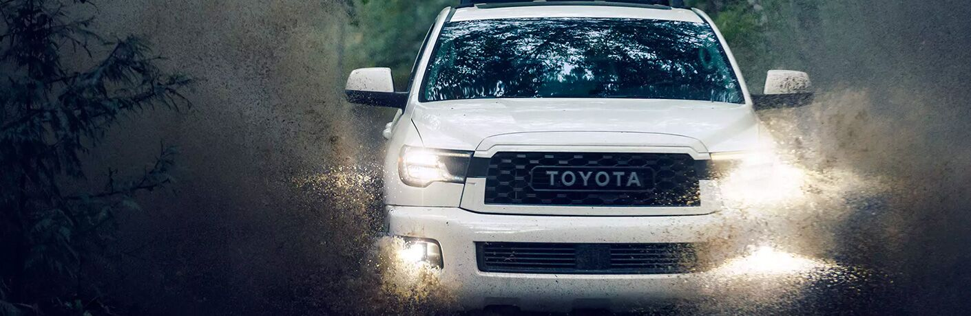 White 2020 Toyota Sequoia TRD Pro driving in rainy weather