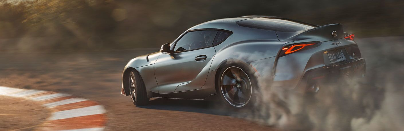 Grey 2020 Toyota Supra driving on a racetrack