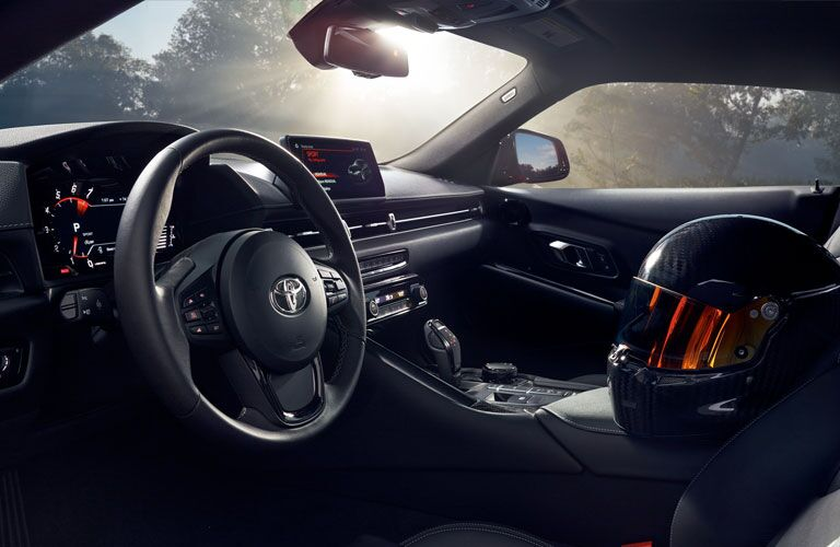 steering wheel and front seat inside 2020 Toyota Supra