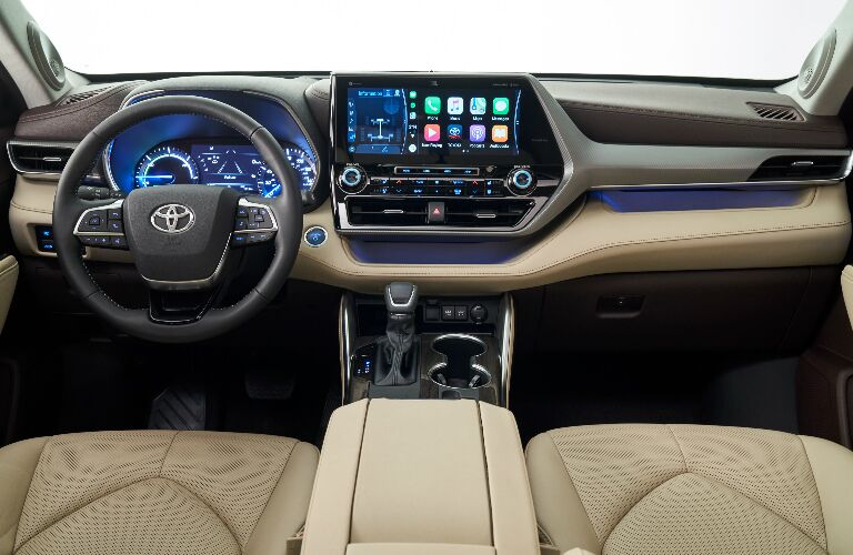 Dashboard and beige front seats in 2020 Toyota Highlander