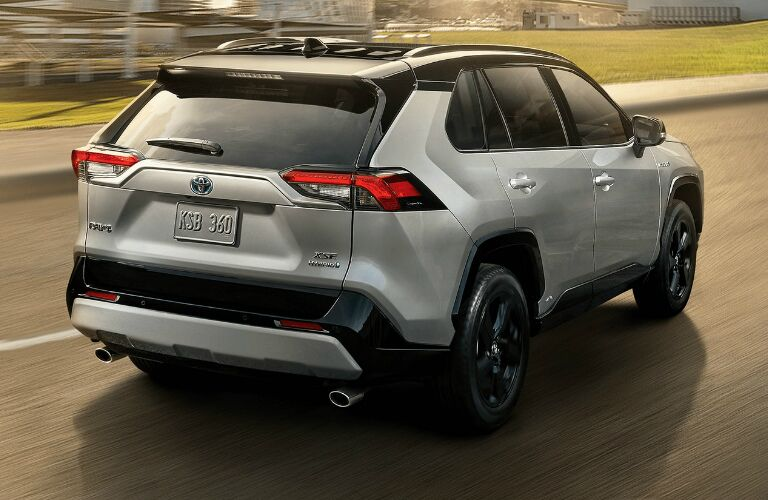 Passenger's side rear angle view of silver 2020 Toyota RAV4
