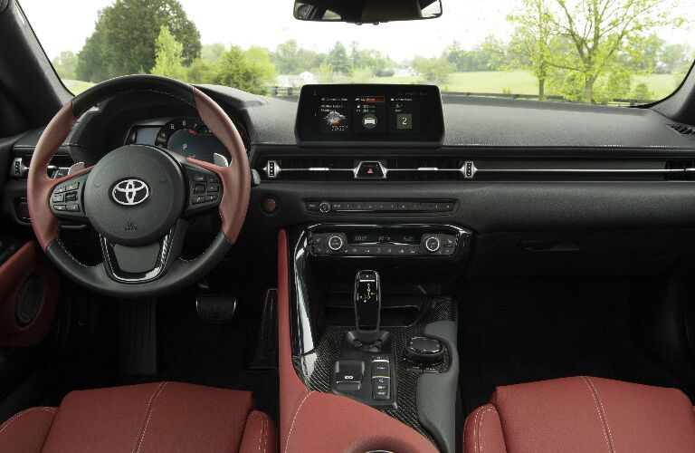 Dashboard and maroon front seats in 2020 Toyota Supra