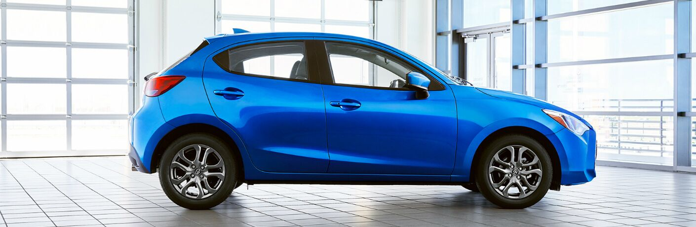 Side view of blue 2020 Toyota Yaris Hatchback
