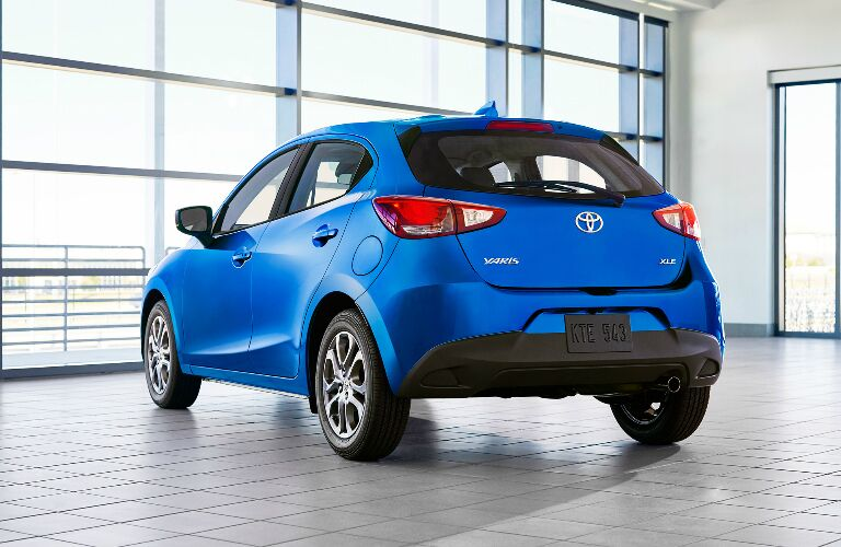 Rear view of blue 2020 Toyota Yaris Hatchback