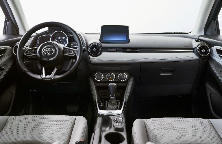 Dashboard and grey front seats in 2020 Toyota Yaris Hatchback