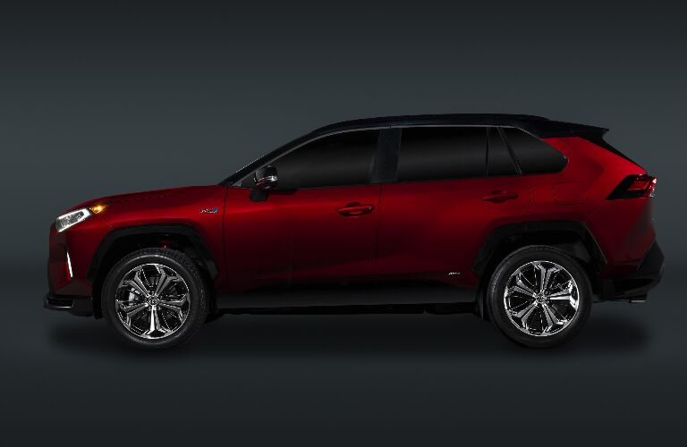Side view of red 2021 Toyota RAV4 Prime