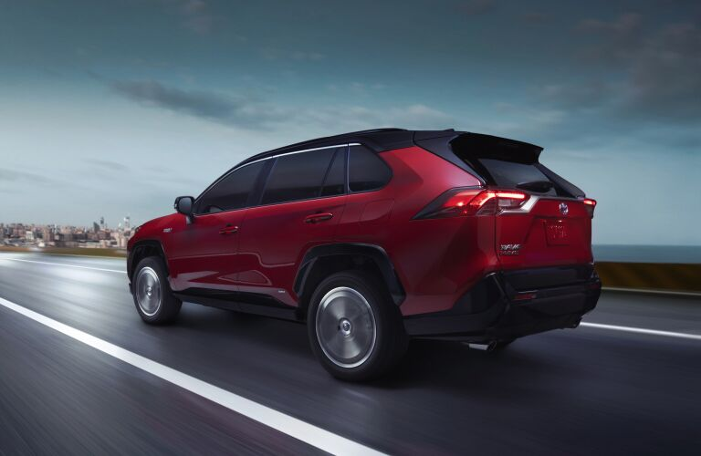 Red 2021 Toyota RAV4 Prime with a city skyline in the background
