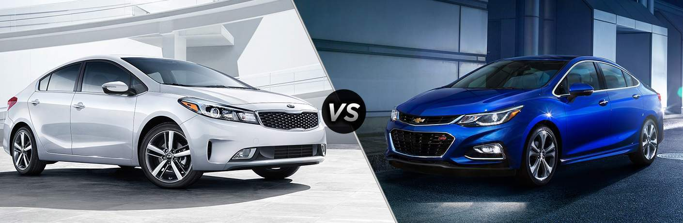 2018 Kia Forte by an overpass vs 2018 Chevrolet Cruze parked by a building