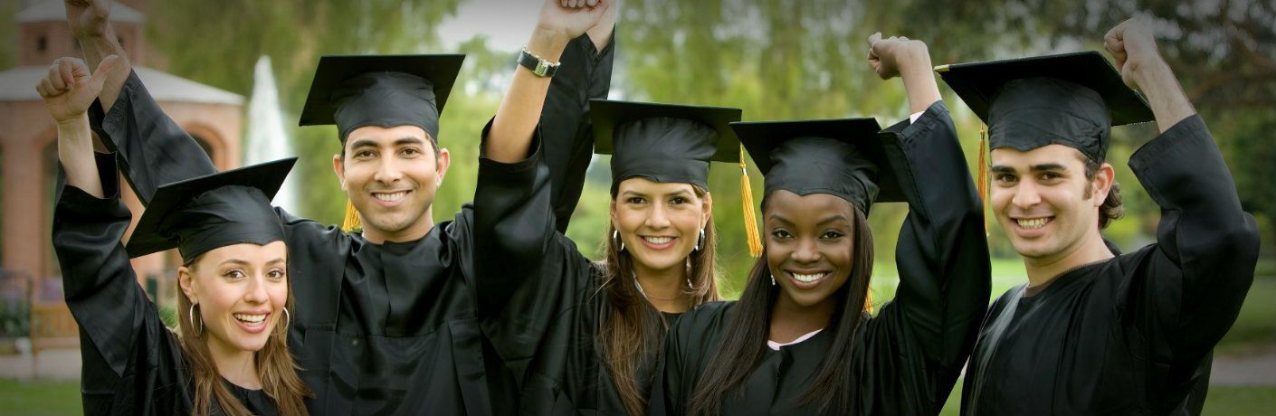 College grads in black caps and gowns