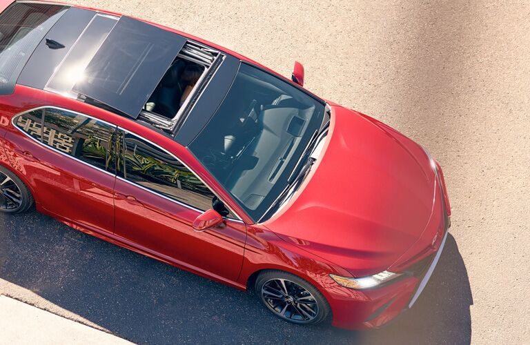 2019 Toyota Camry with red paint color exterior overhead shot of sunroof peeling back