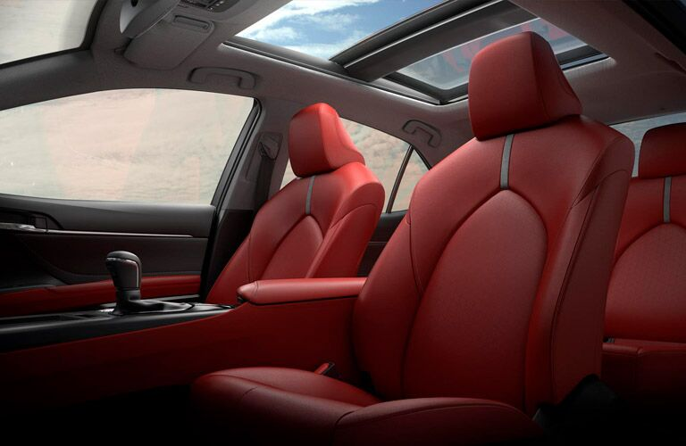 2019 Toyota Camry interior shot of 2-row seating with red upholstery