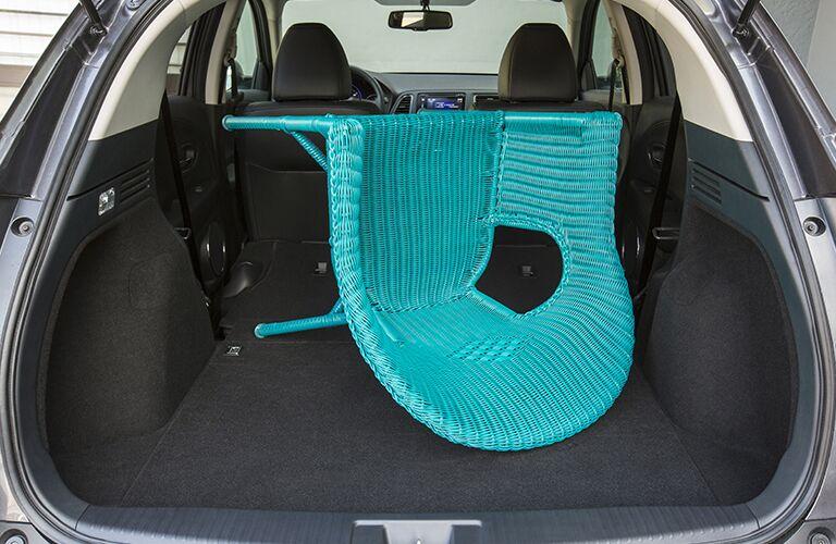 teal chair packed inside a Honda HR-V