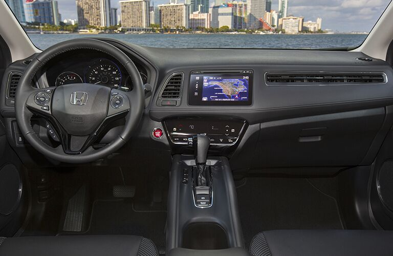 Honda HR-V dashboard and view out the windshield showing skyscrapers in the distance