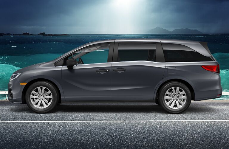 gray honda odyssey by the ocean
