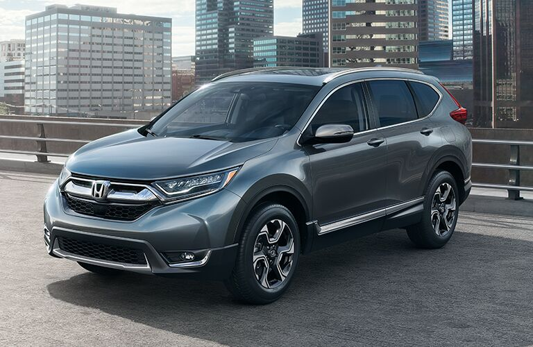 front left view of dark gray honda cr-v parked