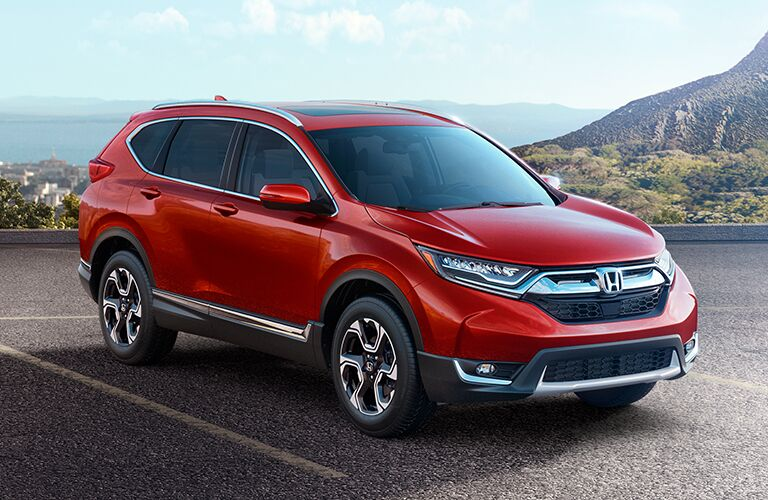 front right view of red honda cr-v parked