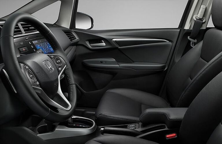 black front seats and steering wheel in honda fit