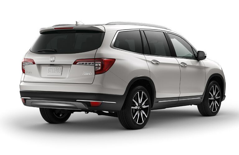 rear view of white honda pilot